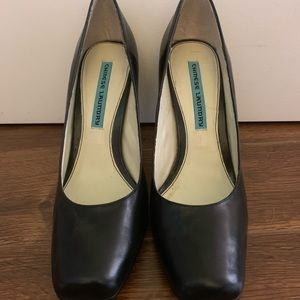 Square toed black leather pumps
